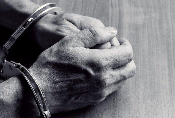 Handcuffs-Handcuffed-Man-Hands-Police-Jail-Prison_1484770455612.jpg