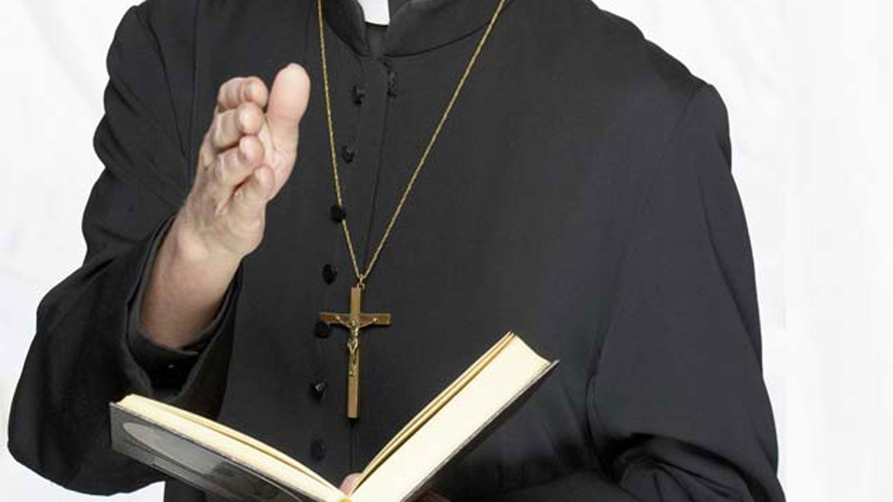 priest-charged_1522243580942.jpg
