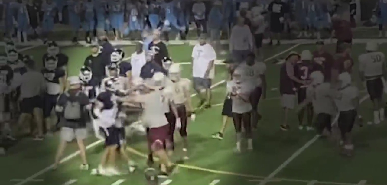 High school football coach on leave after grabbing rival player during fight at scrimmage